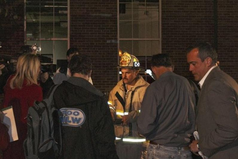 Reporters interviewing fire fighter