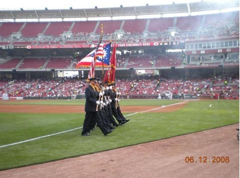 Honor Guard members marching off the field