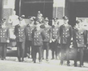 Black and white photo of fire fighters in dress uniform