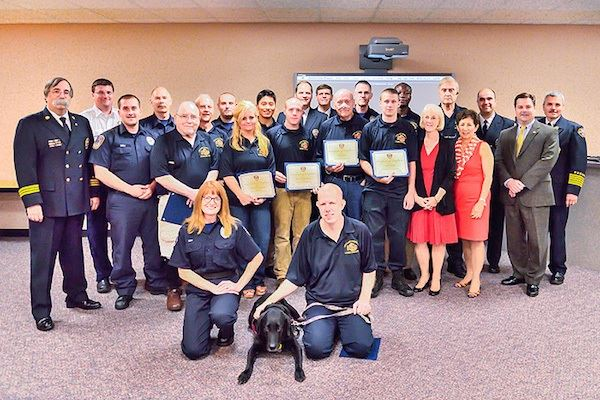 2013 Fire Academy Graduates with ESU members during graduation ceremony