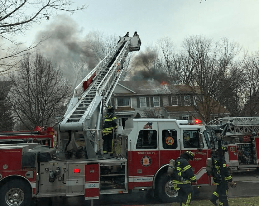 Tower Ladder Deploying for attack at structure fire